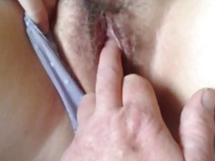 Fingering a hairy MILF pussy