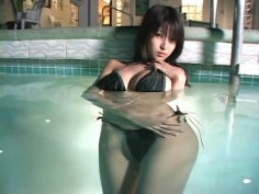 Hot and sexy babe Gekisha X is bathing in a pool