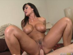 Lisa Ann and Criss Strokes are having a hot 69 position oral sex