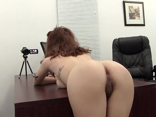 Submissive woman bent over desk
