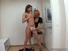 Redhead dominates in a feisty lesbian sex video