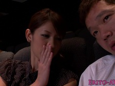 Japanese cutie tugging and sucking in cinema
