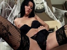 Brunette in a costume and lingerie for Halloween