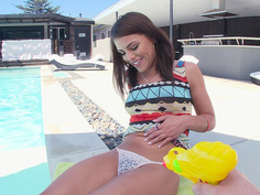 Adriana Chechik chilling by the pool and showing us her bush